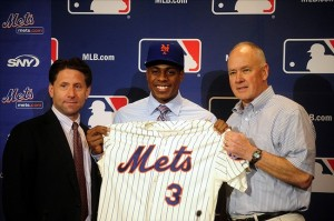 Dec 10, 2013; Orlando, FL, USA; Curtis Granderson smiles as he is introduced by the New York Mets chief operating officer Jeff Wilpon (left) and general manager Sandy Alderson (right) during the MLB Winter Meetings at the Walt Disney World Swan and Dolphin Resort. Mandatory Credit: David Manning-USA TODAY Sports