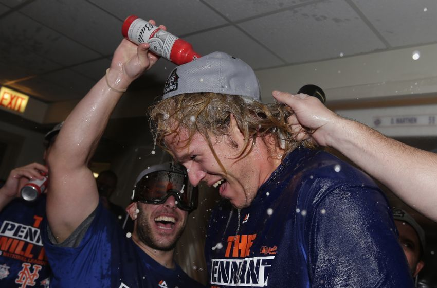 Oct 21, 2015; Chicago, IL, USA; New York Mets starting pitcher Noah Syndergaard celebrates with champagne in the clubhouse after defeating the Chicago Cubs in game four of the NLCS at Wrigley Field. The Mets advance to the World Series with a series sweep. Mandatory Credit: David J. Phllip/Pool Photo via USA TODAY Sports