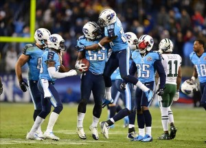 Dec 17, 2012; Nashville, TN, USA; Tennessee Titans linebacker Zach Brown (55) celebrates with corner back Alterraun Verner (20) after recovering a fumble against the New York Jets during the second half at LP Field. The Titans beat the Jets 14-10. Mandatory credit: Don McPeak-USA TODAY Sports