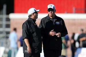 Aug 3, 2013; Cortland, NY, USA; New York Jets offensive coordinator Marty Mornhinweg (left) talks with head coach Rex Ryan during training camp at SUNY Cortland. Mandatory Credit: Rich Barnes-USA TODAY Sports