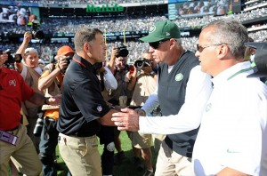 Sep 8, 2013; East Rutherford, NJ, USA; Tampa Bay Buccaneers head coach Greg Schiano (left) and New York Jets head coach Rex Ryan shake hands after the second half at MetLife Stadium. The Jets won 18-17. Mandatory Credit: Joe Camporeale-USA TODAY Sports