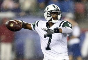 Sep 12, 2013; Foxborough, MA, USA; New York Jets quarterback Geno Smith (7) throws a pass against the New England Patriots during the second half at Gillette Stadium. Mandatory Credit: Mark L. Baer-USA TODAY Sports