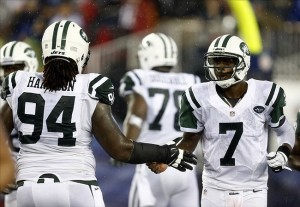 Sep 12, 2013; Foxborough, MA, USA; New York Jets quarterback Geno Smith (7) celebrates a touchdown with nose tackle Damon Harrison (94) during the second half of a game against the New England Patriots at Gillette Stadium. Mandatory Credit: Mark L. Baer-USA TODAY Sports
