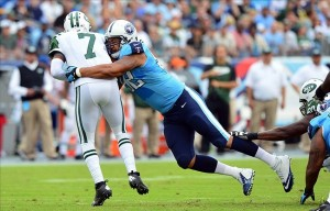 Sep 29, 2013; Nashville, TN, USA; Tennessee Titans defensive end Ropati Pitoitua (92) sacks New York Jets quarterback Geno Smith (7) during the first half at LP Field. Mandatory Credit: Don McPeak-USA TODAY Sports