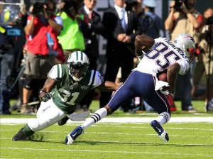 Oct 20, 2013; East Rutherford, NJ, USA; New York Jets cornerback Antonio Cromartie (31) tries to tackle New England Patriots wide receiver Kenbrell Thompkins (85) at MetLife Stadium. Mandatory Credit: William Perlman/THE STAR-LEDGER via USA TODAY Sports