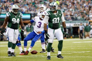 Sep 22, 2013; East Rutherford, NJ, USA; New York Jets defensive end Sheldon Richardson (91) reacts after sacking Buffalo Bills quarterback EJ Manuel (3) during the third quarter at MetLife Stadium. Mandatory Credit: Anthony Gruppuso-USA TODAY Sports