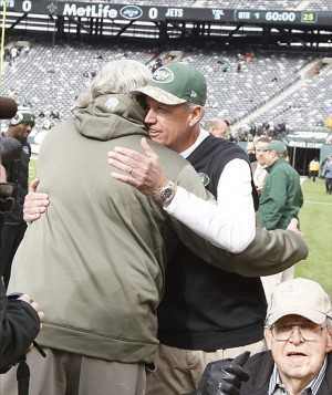 Nov 3, 2013; East Rutherford, NJ, USA; New Orleans Saints defensive coordinator Rob Ryan hugs New York Jets head coach Rex Ryan before the game at MetLife Stadium. Mandatory Credit: William Perlman/The Star-Ledger via USA TODAY Sports