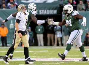 Big Mo and Dame celebrate a sack of Drew Brees. But do the Jets add another young lineman next year for depth?