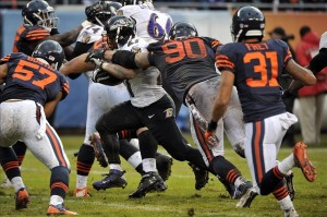 Nov 17, 2013; Chicago, IL, USA; Baltimore Ravens running back Ray Rice (27) is defended by Chicago Bears defensive end Julius Peppers (90) during the first half at Soldier Field. Mandatory Credit: Rob Grabowski-USA TODAY Sports