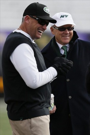 Nov 24, 2013; Baltimore, MD, USA; New York Jets owner Woody Johnson (r) laughs with head coach Rex Ryan (l) prior to the game against the Baltimore Ravens at M