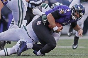 Nov 24, 2013; Baltimore, MD, USA; New York Jets tackle Muhammad Wilkerson (96) sacks Baltimore Ravens quarterback Joe Flacco (5) in the first half at M