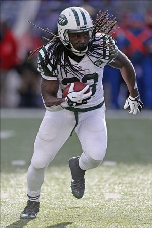 Nov 24, 2013; Baltimore, MD, USA; New York Jets running back Chris Ivory (33) runs with the ball against the Baltimore Ravens in the first half at M