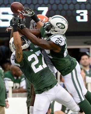 Dec 22, 2013; East Rutherford, NJ, USA; Cleveland Browns wide receiver Josh Gordon (rear) goes up for the ball between New York Jets cornerback Dee Milliner (27) and defensive back Aaron Berry (22) during the game at MetLife Stadium. Mandatory Credit: Robert Deutsch-USA TODAY Sports