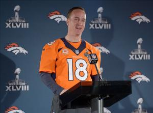 Jan 30, 2014; Jersey City, NJ, USA; Denver Broncos quarterback Peyton Manning (18) at a press conference in advance of Super Bowl XLVIII on the Cornucopia Majesty yacht on the Hudson River. Mandatory Credit: Kirby Lee-USA TODAY Sports