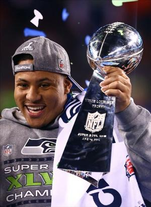 Feb 2, 2014; East Rutherford, NJ, USA; Seattle Seahawks outside linebacker Malcolm Smith holds the Vince Lombardi Trophy after Super Bowl XLVIII against the Denver Broncos at MetLife Stadium. Mandatory Credit: Mark J. Rebilas-USA TODAY Sports