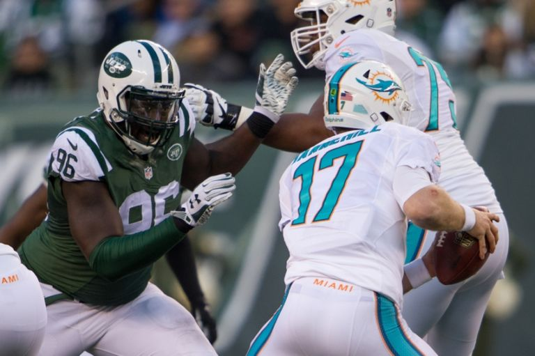 Ryan-tannehill-muhammad-wilkerson-nfl-miami-dolphins-new-york-jets-768x511