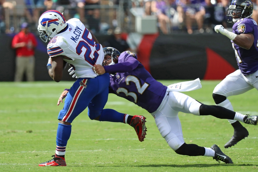 9536553-lesean-mccoy-eric-weddle-nfl-buffalo-bills-baltimore-ravens