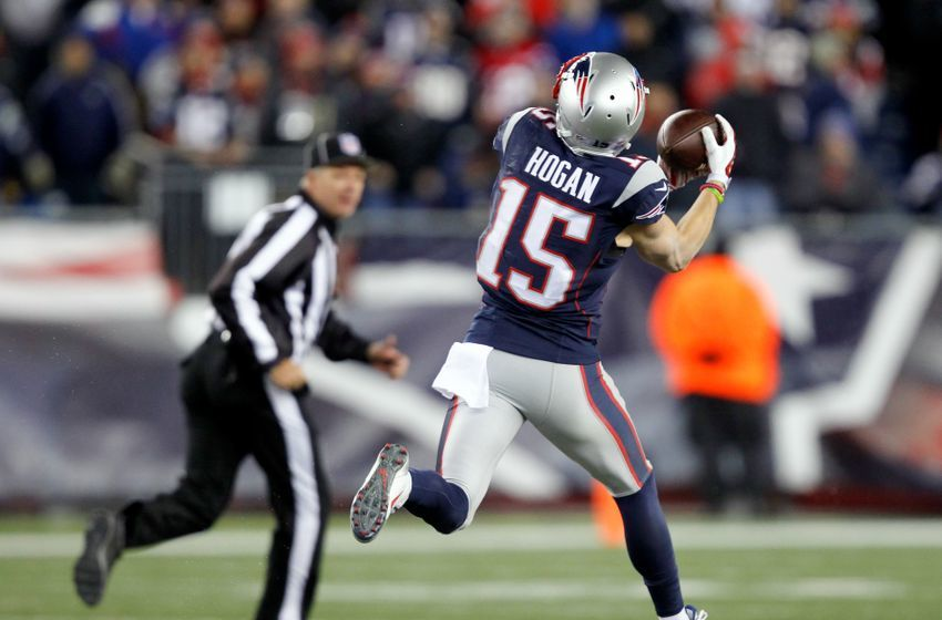 Dec 12, 2016; Foxborough, MA, USA; New England Patriots wide receiver Chris Hogan (15) catches a pass from New England Patriots quarterback Tom Brady (not seen) and runs for a touchdown agains the Baltimore Ravens during the second half at Gillette Stadium. Mandatory Credit: Stew Milne-USA TODAY Sports