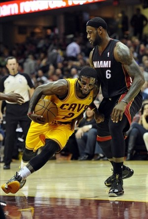 Nov 27, 2013; Cleveland, OH, USA; Cleveland Cavaliers point guard Kyrie Irving (2) drives against Miami Heat small forward LeBron James (6) in the second quarter at Quicken Loans Arena. Mandatory Credit: David Richard-USA TODAY Sports