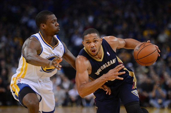 December 17, 2013; Oakland, CA, USA; New Orleans Pelicans shooting guard Eric Gordon (10, right) dribbles the ball against Golden State Warriors small forward Harrison Barnes (40) during the third quarter at Oracle Arena. The Warriors defeated the Pelicans 104-93. Mandatory Credit: Kyle Terada-USA TODAY Sports