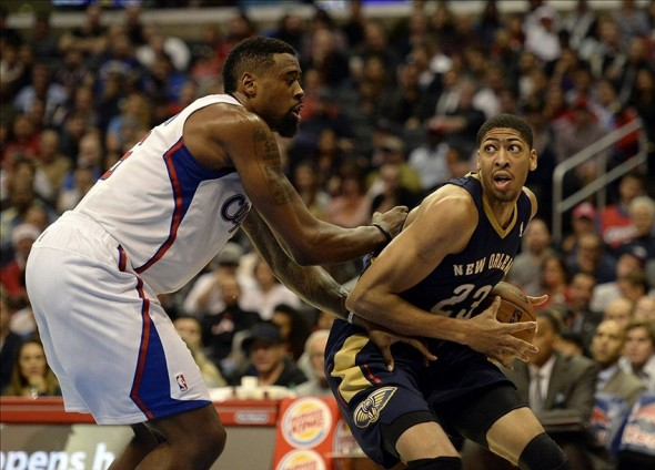 Dec 18, 2013; Los Angeles, CA, USA; Los Angeles Clippers center DeAndre Jordan (6) defends against New Orleans Pelicans power forward Anthony Davis (23) during the third quarter at Staples Center. Mandatory Credit: Richard Mackson-USA TODAY Sports
