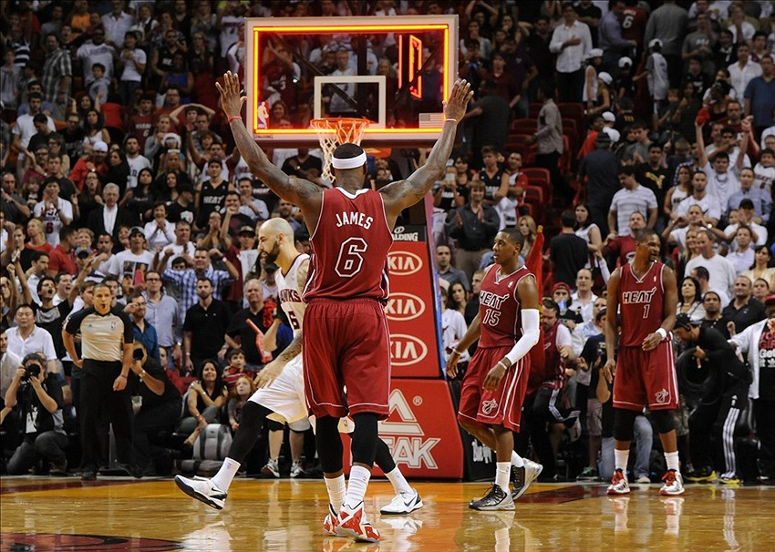 Dec 23, 2013; Miami, FL, USA; Miami Heat small forward LeBron James (6) celebrates their 121-119 overtime win against the Atlanta Hawks at the American Airlines Arena. Mandatory Credit: Steve Mitchell-USA TODAY Sports
