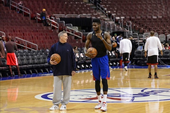Dec 14, 2013; Philadelphia, PA, USA; Philadelphia 76ers head coach Brett Brown and center Nerlens Noel (4) talk while shooting baskets prior to playing the Portland Trail Blazers at the Wells Fargo Center. Mandatory Credit: Howard Smith-USA TODAY Sports