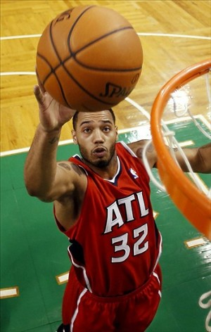 Dec 31, 2013; Boston, MA, USA; Atlanta Hawks power forward Mike Scott (32) lays the ball in during the fourth quarter of Atlanta