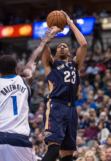 Jan 11, 2014; Dallas, TX, USA; New Orleans Pelicans power forward Anthony Davis (23) shoots over Dallas Mavericks center Samuel Dalembert (1) during the first half at the American Airlines Center. Mandatory Credit: Jerome Miron-USA TODAY Sports