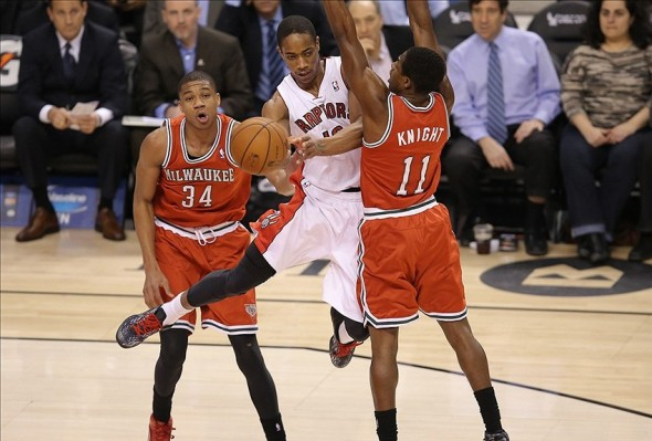 Jan 13, 2014; Toronto, Ontario, CAN; Toronto Raptors guard DeMar DeRozan (10) passes the ball against the Milwaukee Bucks at Air Canada Centre. Mandatory Credit: Tom Szczerbowski-USA TODAY Sports