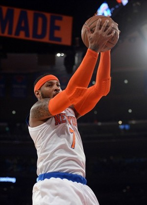Jan 17, 2014; New York, NY, USA; New York Knicks small forward Carmelo Anthony (7) grabs a rebound against the Los Angeles Clippers during the first half at Madison Square Garden. Mandatory Credit: Joe Camporeale-USA TODAY Sports