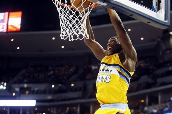 Jan 31, 2014; Denver, CO, USA; Denver Nuggets forward Kenneth Faried (35) dunks the ball during the first half against the Toronto Raptors at Pepsi Center. Mandatory Credit: Chris Humphreys-USA TODAY Sports
