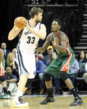Feb 1, 2014; Memphis, TN, USA; Memphis Grizzlies center Marc Gasol (33) drives against Milwaukee Bucks center Larry Sanders (8) at FedExForum. Mandatory Credit: Nelson Chenault-USA TODAY Sports