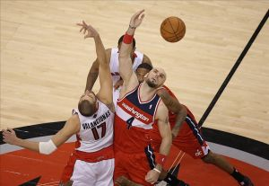 Feb 27, 2014; Toronto, Ontario, CAN; Washington Wizards center Marcin Gortat (4) wins the opening tip-off of the second overtime period against Toronto Raptors center Jonas Valanciunas (17) at Air Canada Centre. Mandatory Credit: Tom Szczerbowski-USA TODAY Sports