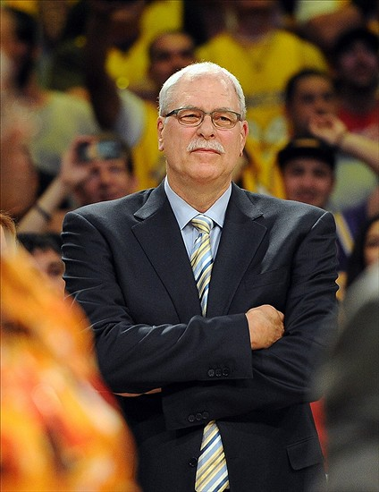 Apr 2, 2013; Los Angeles, CA, USA; Phil Jackson looks on as the jersey of Los Angeles Lakers former player Shaquille O