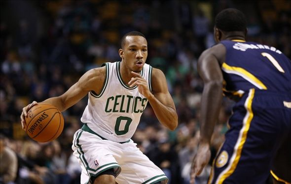 Nov 22, 2013; Boston, MA, USA; Boston Celtics point guard Avery Bradley (0) dribbles the ball against Indiana Pacers shooting guard Lance Stephenson (1) during the first half at TD Garden. Mandatory Credit: Mark L. Baer-USA TODAY Sports