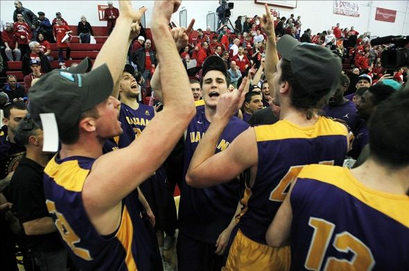 Mar 15, 2014; Stony Brook, NY, USA; Albany Great Danes players celebrate after defeating the Stony Brook Seawolves in the championship game of the America East college basketball tournament at Pritchard Gym. The Graet Danes won 69-60.Mandatory Credit: Andy Marlin-USA TODAY Sports