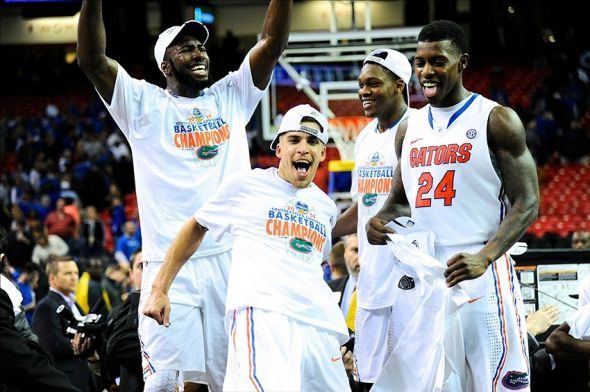 Mar 16, 2014; Atlanta, GA, USA; Florida Gators players react after defeating the Kentucky Wildcats in the championship game for the SEC college basketball tournament at Georgia Dome. Florida defeated Kentucky 61-60. Mandatory Credit: Dale Zanine-USA TODAY Sports