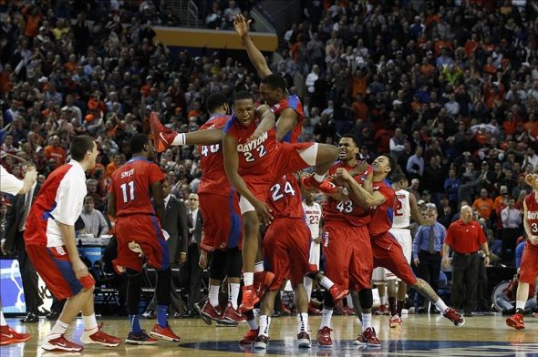 Mar 20, 2014; Buffalo, NY, USA; Dayton Flyers celebrate after beating Ohio State Buckeyes in the men