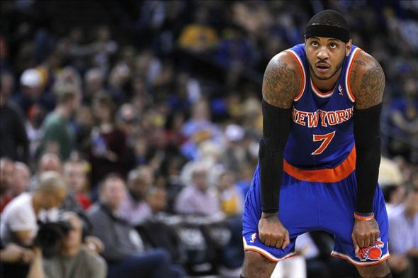 Mar 30, 2014; Oakland, CA, USA; New York Knicks forward Carmelo Anthony (7) rest on the court against the Golden State Warriors in the third quarter at Oracle Arena. The Knicks won 89-84. Mandatory Credit: Cary Edmondson-USA TODAY Sports
