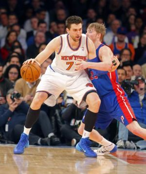 Jan 7, 2014; New York, NY, USA; New York Knicks power forward Andrea Bargnani (77) works against Detroit Pistons small forward Kyle Singler (25) during the first half at Madison Square Garden. Mandatory Credit: Jim O