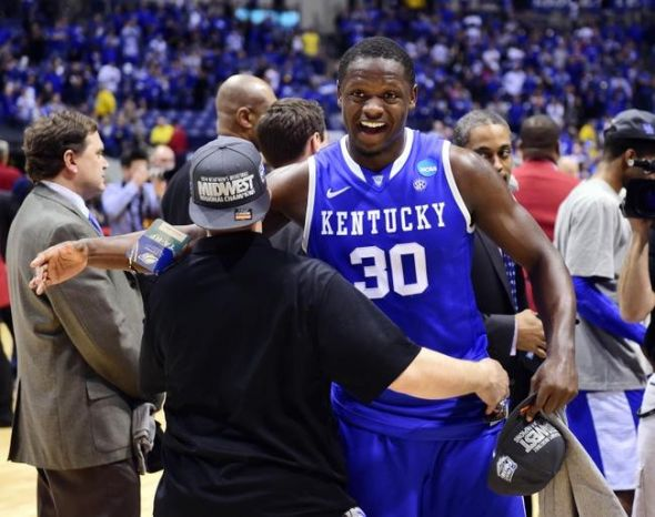 Mar 30, 2014; Indianapolis, IN, USA; Kentucky Wildcats forward Julius Randle (30) celebrates after defeating the Michigan Wolverines in the finals of the midwest regional of the 2014 NCAA Mens Basketball Championship tournament at Lucas Oil Stadium. Mandatory Credit: Bob Donnan-USA TODAY Sports