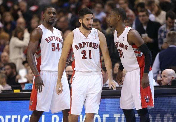 Dec 13, 2013; Toronto, Ontario, CAN; Toronto Raptors guard Greivis Vasquez (21), forward Patrick Patterson (54) and guard Terrence Ross (31) stand on the court against the Philadelphia 76ers at Air Canada Centre. The Raptors won 108-100. Mandatory Credit: Tom Szczerbowski-USA TODAY Sports
