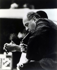 Red Auerbach, lighting his trademark cigar near the end of another Boston Celtics victory. (US PRESSWIRE)