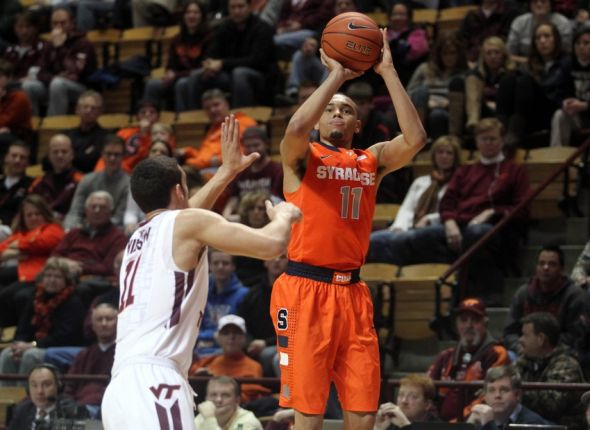Jan 7, 2014; Blacksburg, VA, USA; Syracuse Orange guard Tyler Ennis (11) shoots the ball against Virginia Tech Hokies guard Devin Wilson (11) during the first half at Cassell Coliseum. Mandatory Credit: Peter Casey-USA TODAY Sports