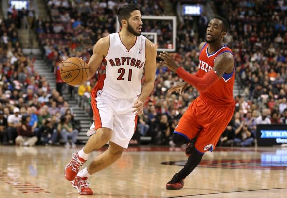 Dec 13, 2013; Toronto, Ontario, CAN; Toronto Raptors guard Greivis Vasquez (21) dribbles the ball against Philadelphia 76ers guard Tony Wroten (8) at Air Canada Centre. The Raptors beat the 76ers 108-100. Mandatory Credit: Tom Szczerbowski-USA TODAY Sports