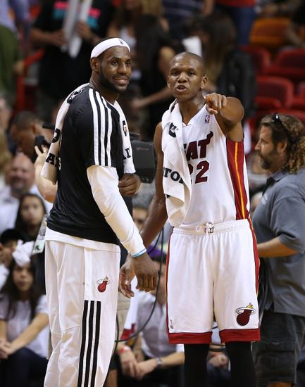 Apr 2, 2014; Miami, FL, USA; Miami Heat forward LeBron James (left) and forward James Jones (right) talk in the second half of a game against the Milwaukee Bucks at American Airlines Arena. The Heat won 96-77. Mandatory Credit: Robert Mayer-USA TODAY Sports