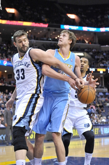 Apr 4, 2014; Memphis, TN, USA; Memphis Grizzlies center Marc Gasol (33) knocks the ball loose against Denver Nuggets forward Jan Vesely (24) during the first half at FedExForum. Mandatory Credit: Jim Brown-USA TODAY Sports