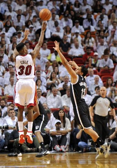 May 6, 2014; Miami, FL, USA; Miami Heat guard Norris Cole (30) shoots over Brooklyn Nets guard Jorge Gutierrez (13) during the second half in game one of the second round of the 2014 NBA Playoffs at American Airlines Arena. Mandatory Credit: Steve Mitchell-USA TODAY Sports