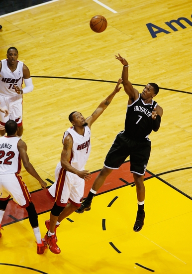 May 14, 2014; Miami, FL, USA; Brooklyn Nets guard Joe Johnson (7) shoots the ball over Miami Heat forward Rashard Lewis (9) in the first half in game five of the second round of the 2014 NBA Playoffs at American Airlines Arena. Mandatory Credit: Robert Mayer-USA TODAY Sports